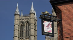Magna carta pub sign and lincoln cathedral, england Stock Footage