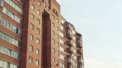 Modern apartment building against the sky, city sleeping area Stock Footage