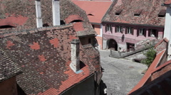 People walking, beautiful European medieval town, architecture, terracotta roofs Stock Footage