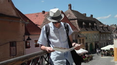 Tourists using a map, street, old beautiful houses, medieval town, Europe Stock Footage