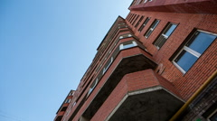 View from below at red apartment building Stock Footage