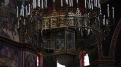 Giant chandelier, Orthodox church, painted walls, Christianity, tilt up Stock Footage