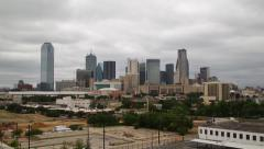 Stock Video Footage of Tilting wide shot of Dallas Skyline on a cloudy day.