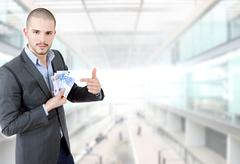 Young casual man with lots of money at the office Stock Photos