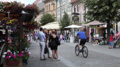 Young people talking, street restaurants, bicycles, beautiful European town Stock Footage