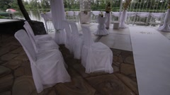 White weddings chairs in the street Stock Footage