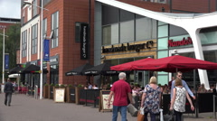 People walk past handmade burger co and nandos restaurants, lincoln, england Stock Footage