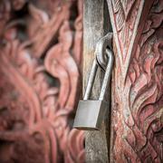 padlock key - stock photo