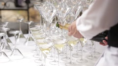 Champaign being pored into glasses. Stock Footage
