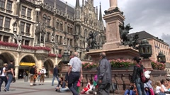 ULTRA HD 4K Tourist people relax rest Marian Column Marienplatz square Munich  Stock Footage