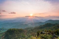 Beautiful sunrise in the mountains landscape Stock Photos