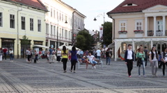 People on bench in central square, restaurants, old city, Europe, time lapse Stock Footage