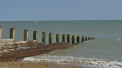 Beach groyne prevents longshore drift england 4k Stock Footage