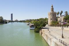 the gold tower and guadalquivir river - stock photo