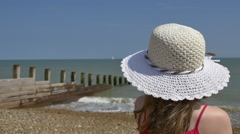 Young Girl Gazes at Distant Boat on Summer Sea 4K Stock Footage