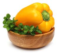 Yellow capsicum with mint leaves Stock Photos