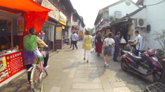 Glidecam Qibao Market Day side view 4 24 fps - stock footage