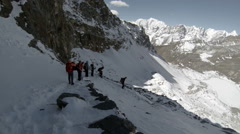 Group of tourists coming down from the Renjo Pass. Himalayas, Nepal. FULL HD Stock Footage