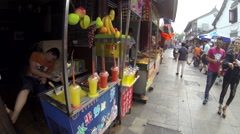 Glidecam Qibao Market Day front view 4 24 fps Stock Footage