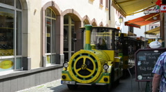 Electric tourist train shuttle runs through Cochem (Mosel Valley) Stock Footage