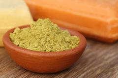 henna powder with other beautification product - stock photo