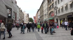 ULTRA HD 4K Busy shopping street tourist visit shop famous Munich city day crowd Stock Footage