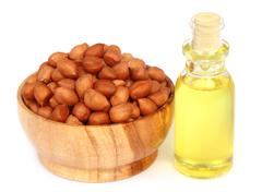 Peanut and oil over white background Stock Photos