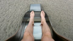 Legs of boy on metal slider. Movement of body Stock Footage