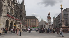Marienplatz Mary's square ancient gate old town Munich city tourist people visit Stock Footage