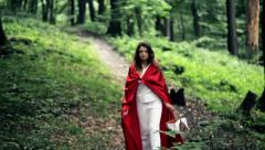 Red riding hood with basket walking in the forest HD Stock Footage