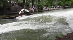 River surfing spot in munich, located in the park englischer garten, forms a sta Stock Footage
