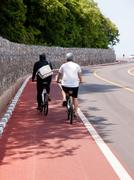 two man ride bicycle on  bicycle lane - stock photo