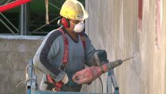 Stock Video Footage of Work 10 Cutting Concrete with a Pneumatic Hammer