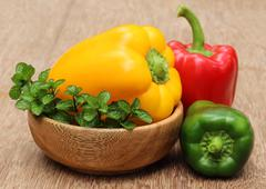 capsicum with mint leaves on a bowl - stock photo