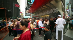 tourists and New Yorkers crowd around TKTS in Times Square New York NYC USA - stock footage