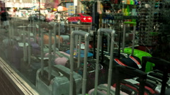 Suitcases and Luggage in Store Window in Times Square, New York City NYC USA Stock Footage