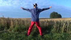 Funny farmers with clown cap morning exercise on field Stock Footage
