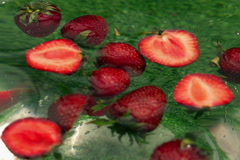 Strawberries spinning in the water, closeup, slow motion shot Stock Footage