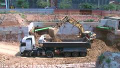Work 01 Bulldozer Filling Dump Truck Stock Footage