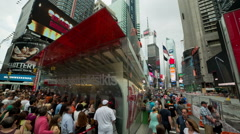 Tourists and New Yorkers crowd around TKTS in Times Square New York NYC USA Stock Footage