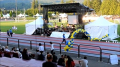 Time lapse of people walking on stadium race track with relay for life sepcia Stock Footage