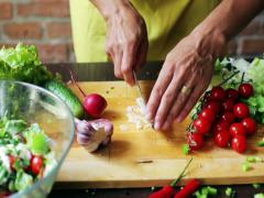 Woman cutting garlic into small pieces, closeup Stock Footage