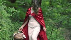 Happy Red riding hood with basket walking in forest HD Stock Footage