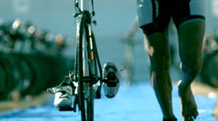 Triathlete Feet Running with Bike in Super Slow Motion 2 Stock Footage