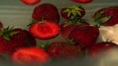 Strawberries spinning in water, closeup, slow motion shot Stock Footage