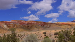 Stock video footage time lapse clouds fly over the red rocks Stock Footage