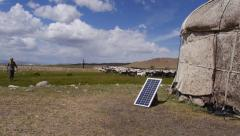 Stock video footage yurt nomad and a flock of sheep and solar panels - stock footage