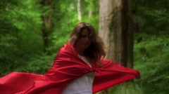 Woman in red cape turning round in forest, super slow motion, 240fps HD - stock footage