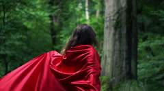 Happy woman in red cape turning round in forest, super slow motion, 240fps HD Stock Footage