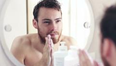 Male grooming and moisturizing Stock Footage